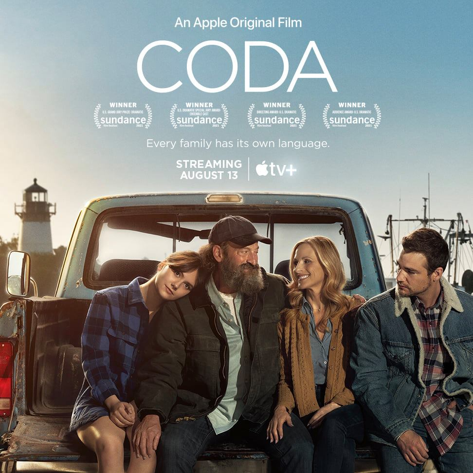 CODA film will be shown on August 13 at Apple TV+. About CODA - Ruby is the only hearing member of a deaf family from Gloucester, Massachusetts. At 17, she works mornings before school to help her parents and brother keep their fishing business afloat. But in joining her high school's choir club, Ruby finds herself drawn to both her duet partner and her latent passion for singing. [ID Description for ALT IMAGE: A family of four sitting and cuddling together on the back of the truck against blue sky, light house and fishing boat in the background]